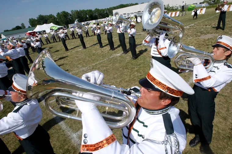 Pioneer Drum and Bugle Corps members perform during the corps' 50th anniversary gathering in July 2011.