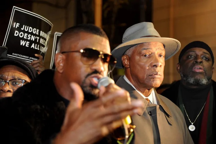 Julius Erving waits to speak at a rally in support of rapper Meek Mill.