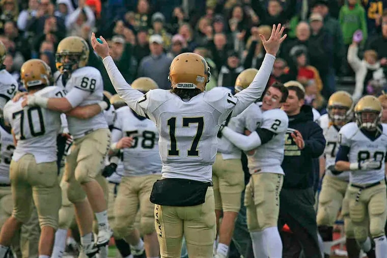 La Salle quarterback Matt Magarity (17) leads the postgame cheers as the Explorers celebrate a return to the state championship game Saturday. Magarity threw two touchdown passes in the wild semifinal, as neither team backed down the whole way.