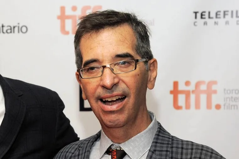 """FILE - In this Sept. 6, 2013 file photo, director Richard Glatzer poses at the premiere of the film """"The Last of Robin Hood"""" at the Toronto International Film Festival at the Isabel Bader Theater in Toronto. Glatzer, who directed """"Still Alice,"""" a film that garnered actress Julianne Moore an Oscar for best actress last month, died Tuesday, March 10, in Los Angeles after a four-year battle with ALS. He was 63. (Photo by Chris Pizzello/Invision/AP, File)"""