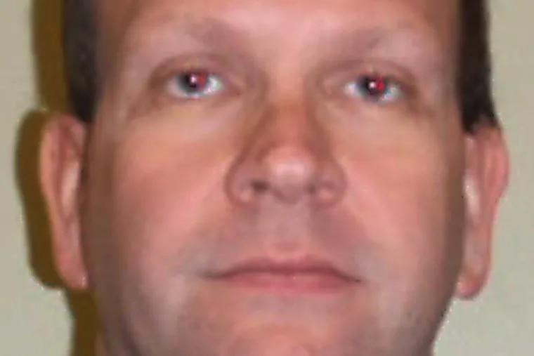 John Martin hid cameras at Glou. Catholic, police said.