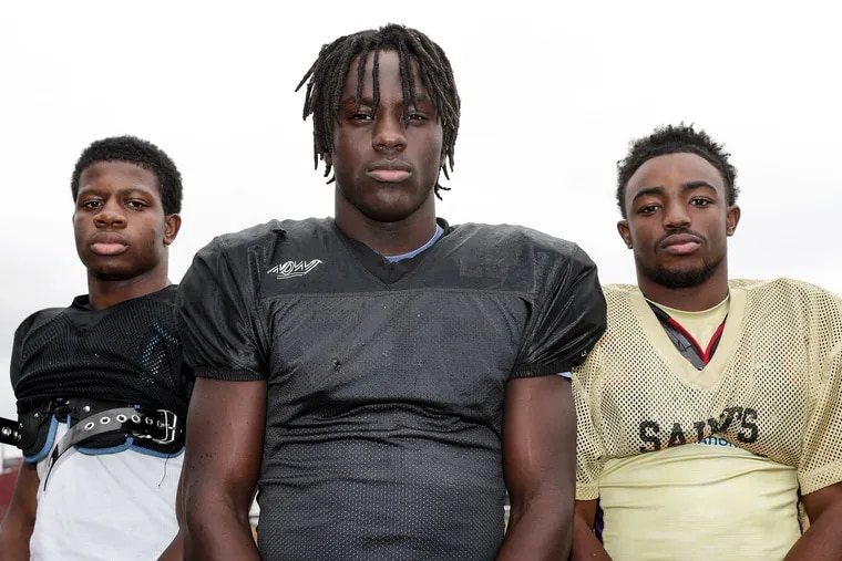 Neuman Goretti High seniors Ubayd Steed (left), Ronald Holmes (center), and Malik Griffin have led the way as the Saints have burst to a 7-0 record, including a 4-0 mark in the Philadelphia Catholic League's Blue Division.