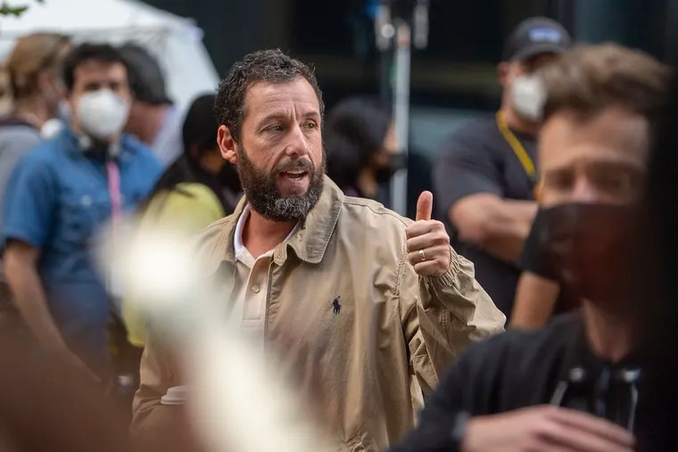 """Adam Sandler greets fans while filming his movie, tentatively called """"Hustle,"""" at 18th and Arch Streets in Philadelphia on Sept. 20, 2021."""