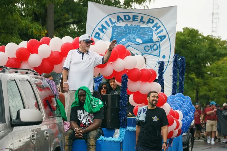 Patrick Eiding, top left waving, President of the Philadelphia Council AFL-CIO, representing over 100 local unions in the Philadelphia area, shown here on a float, during the Labor Day parade on South Columbus Blvd., in Philadelphia, September 2, 2019.