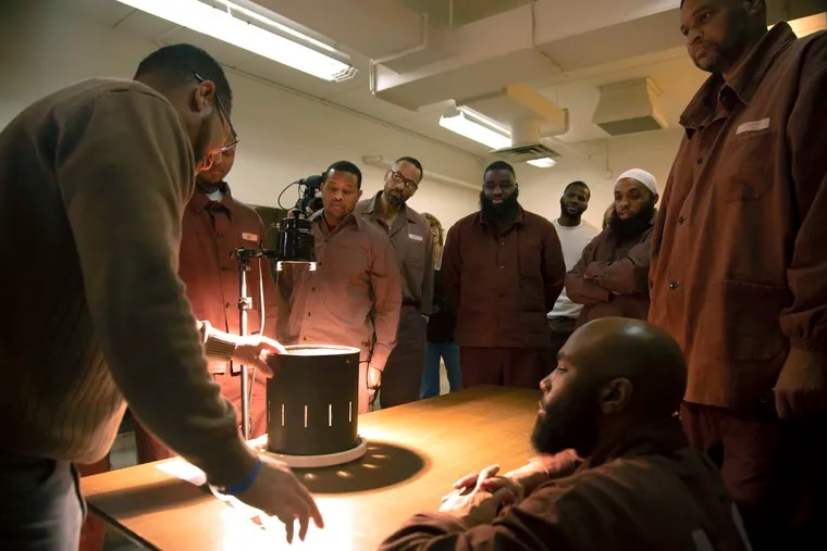 Men incarcerated at the State Correctional Institution-Chester use a zoetrope, an early animation technology, to create moving images for their animations to be shown at Eastern State Penitentiary.