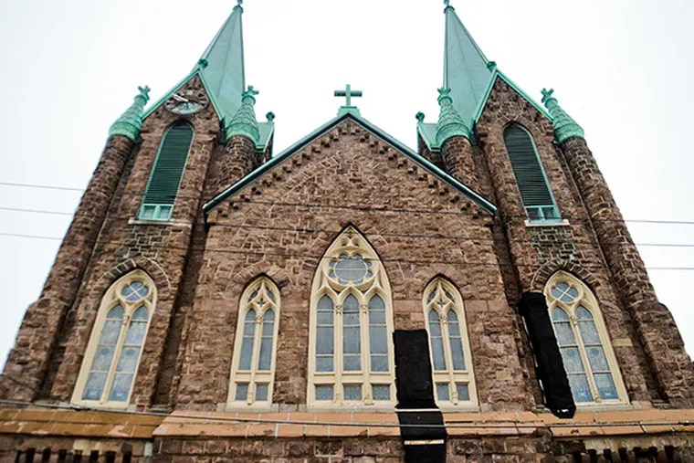 St. Laurentius Church in Fishtown moved a step closer to possible demolition as Archbishop Charles J. Chaput issued an order Sunday decertifying the building as a Roman Catholic church (VIVIANA PERNOT/Staff Photographer)