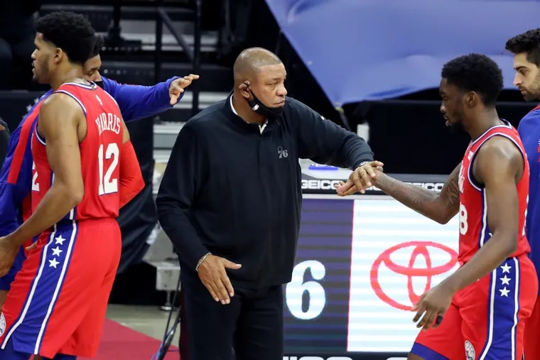 Sixers coach Doc Rivers greets Shake Milton in the fourth quarter on Wednesday against the Wizards.