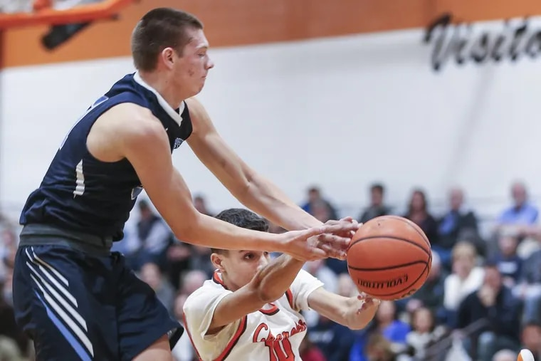 Shawnee's Dean Doll tries to keep the ball from Cherokee's Zach Morgan during the 2nd quarter in Marlton, NJ, Tuesday, December 19, 2017. . Shawnee beats Cherokee 70-51.