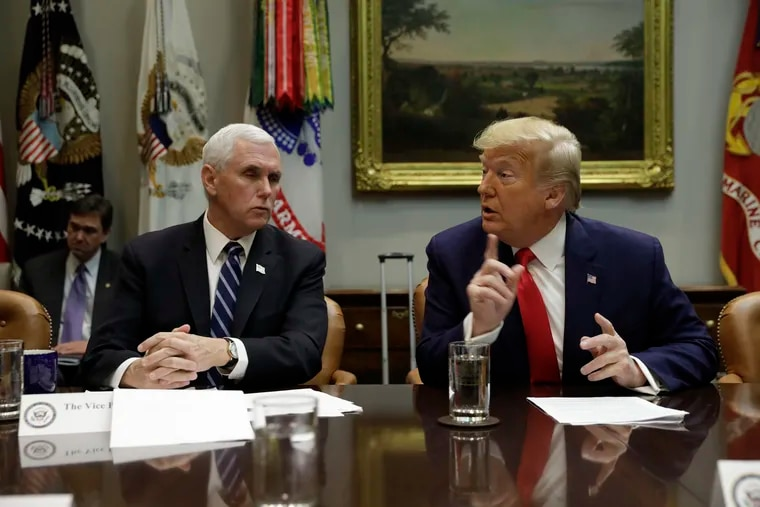 U.S. President Donald Trump with Vice President Mike Pence, left, participates in a Coronavirus briefing with Airline CEOs at the White House on March 4, 2020 in Washington, D.C.