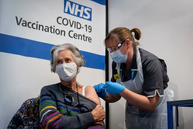 Doreen Brown, 85, receives the first of two Pfizer/BioNTech COVID-19 vaccine jabs administered at Guy's Hospital in London, on Tuesday. U.K. health authorities gave emergency approval to the shots last week.