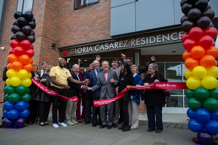 A ribbon cutting takes place outside the first-ever Pennsylvania residence for LGBTQ homeless people in North Philadelphia.
