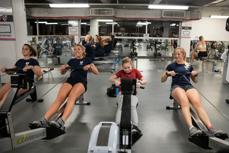 Keira McGrenehan, 10, uses the ergometer machine while training with the Penn women's rowing team at the university's Varsity Lifting Center.