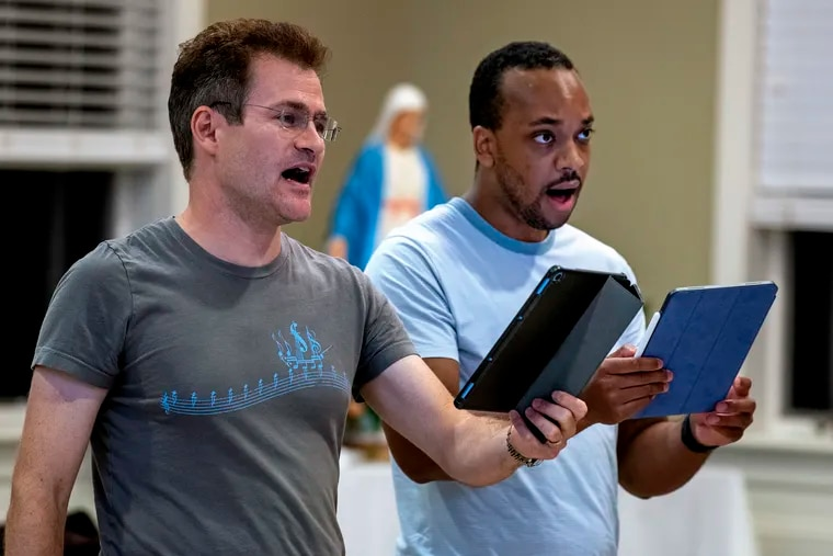 Nicholas Weininger (left) and Julian Dorsey (right) sing at St. Paul's Church in Stone Harbor Oct. 7, 2021, as Coro Mundi holds their first in person rehearsal since emerging from its coronavirus cocoon to once again sing together. The choir made its debut in 2018 in Italy, and had planned for another tour in summer 2020.