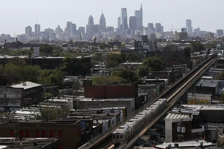 The Philadelphia skyline is seen behind an eastbound SEPTA train on the Market-Frankford line.