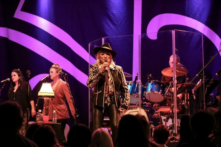 Country star Tanya Tucker fronted a top-notch, eight-person ensemble including two backup singers, one of whom was her daughter, Presley.