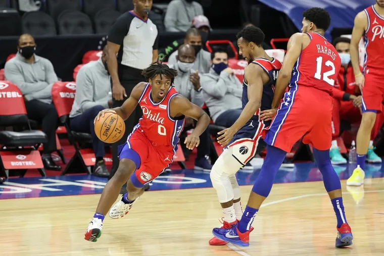 Tyrese Maxey (left) showed great potential in his first NBA game.