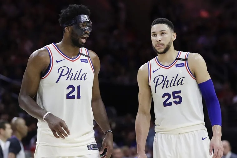Center Joel Embiid  (left) and point guard Ben Simmons led the Sixers to a turnaround season.