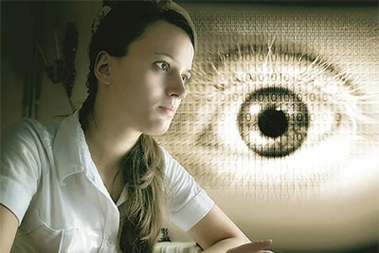 The school district says the webcam surveillance is for security. (Daily news photo illustration)