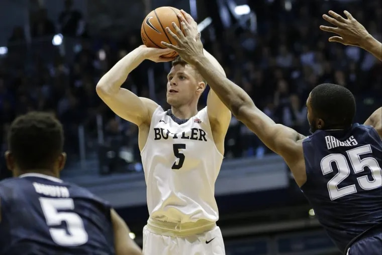 Butler guard Paul Jorgensen (5) shoots in front of Villanova defenders Phil Booth (5) and Mikal Bridges (25) in the first half of Villanova's 101-93 loss on Saturday.