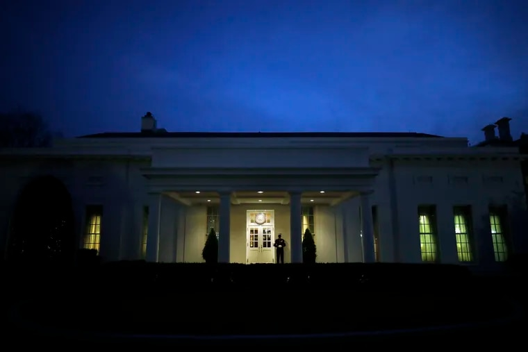 A Marine stands on duty outside the West Wing while President Donald Trump is in the Oval Office of the White House in Washington, D.C., on Jan. 11, 2021.