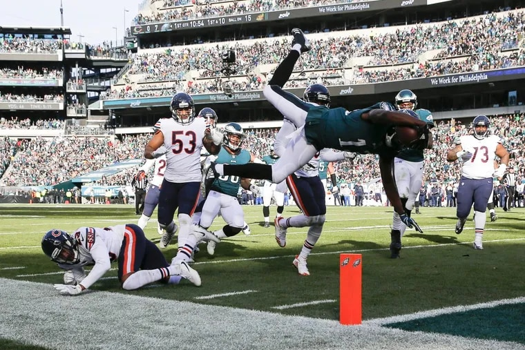 Eagles wide receiver Nelson Agholor leaps into the end zone for a second-quarter touchdown against the Chicago Bears on Sunday, November 26, 2017 in Philadelphia.
