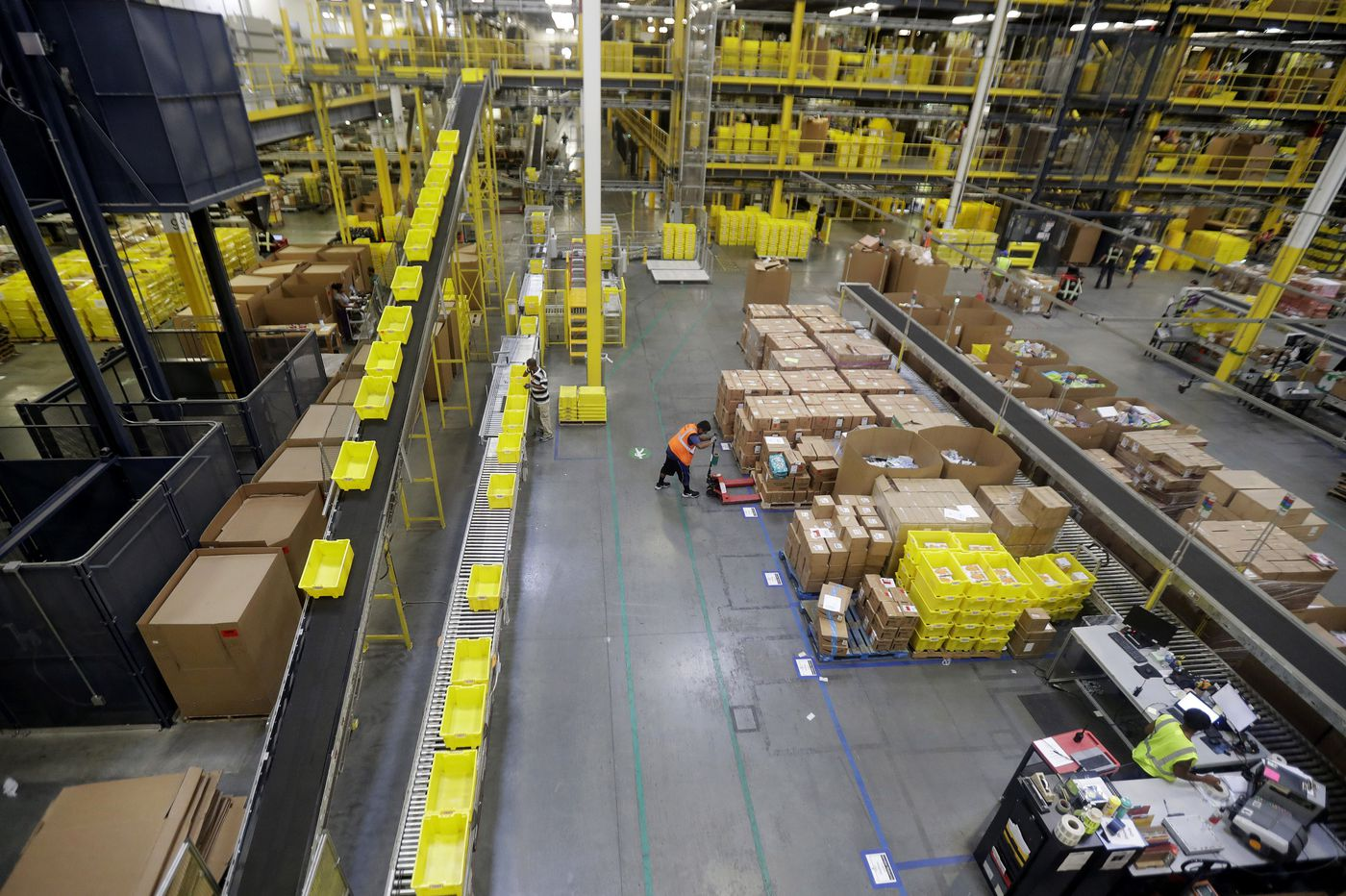 Amazon is raising its minimum wage to $15 an hour. Here's what it could mean for Philly