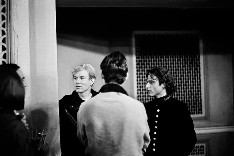 Andy Warhol and Gerard Malanga at the Exploding Plastic Inevitable at the Young Men's & Women's Hebrew Association on south Broad Street in December 1966.