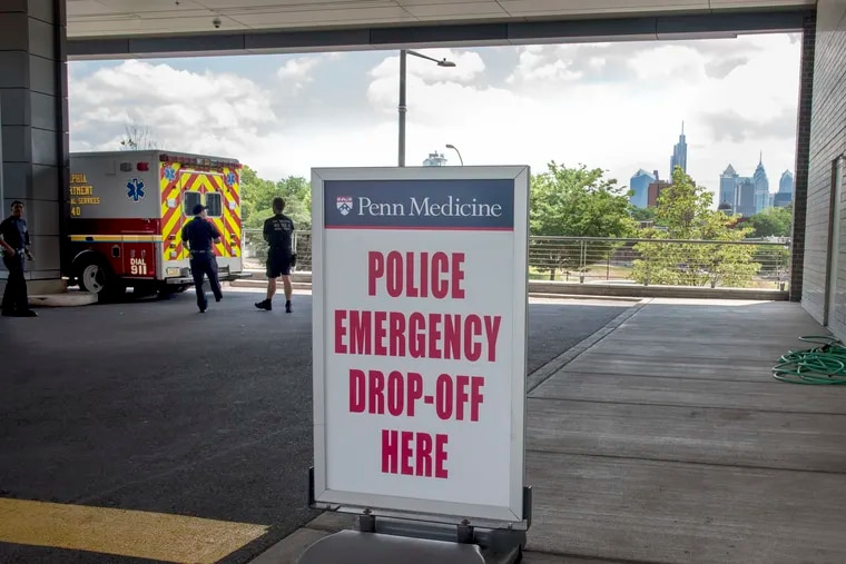 A sign is posted outside Penn Presbyterian Medical Center Level 1 Trauma Center at 38th & Powelton June 24, 2018. A tweet posted Saturday night by Penn trauma surgeon Mark about doors specifically for Phila. Police to quickly drop off gunshot victims has drawn response to the tweet expressing regret that this is what life in America has come to. TOM GRALISH / Staff Photographer