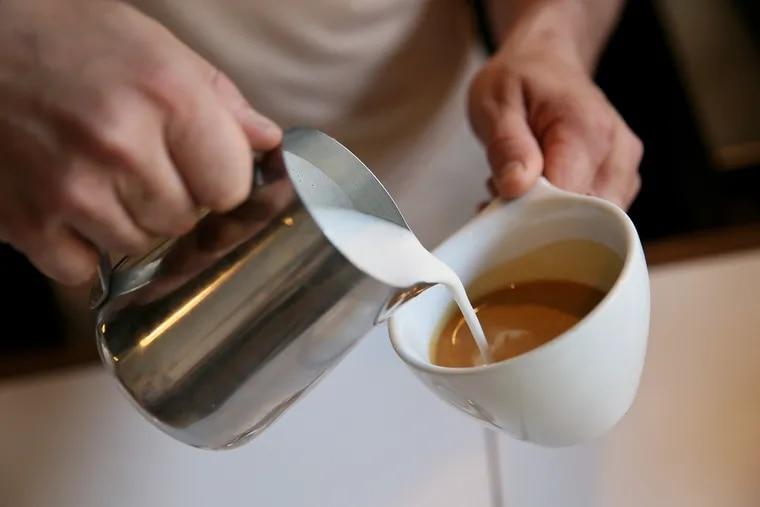 Barista Caleb Lewis makes a latte at Cafe Volan in Asbury Park, N.J., last year.