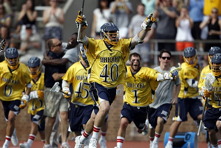 Drexel players celebrate their win over Penn in the first round of the NCAA Lacrosse Championships at Franklin Field on Sunday, May 11, 2014. (Yong Kim/Staff Photographer)