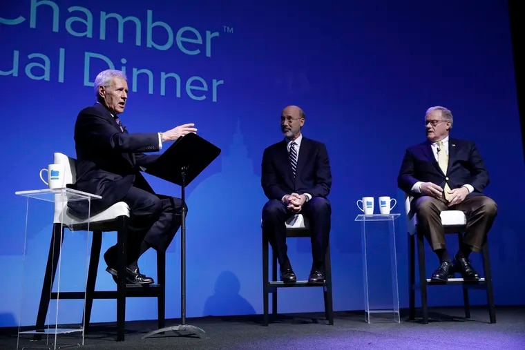 Alex Trebek, left, moderates a gubernatorial debate between Democratic Gov. Tom Wolf, center, and Republican Scott Wagner in Hershey, Pa., Monday, Oct. 1, 2018. The debate is hosted by the Pennsylvania Chamber of Business and Industry.