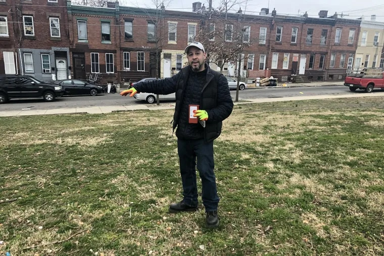 Raphael Feliciano, aka Mr. Clean and Safe Parks, standing inside McPherson Square Park, one of the many neighborhood parks he tends to daily.