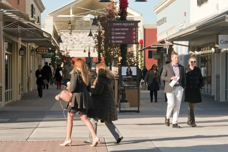 Shoppers peruse the stores at the Gloucester Premium Outlets in Blackwood, N.J. The region's shopping centers anticipate a big Black Friday, so shoppers should expect crowds.