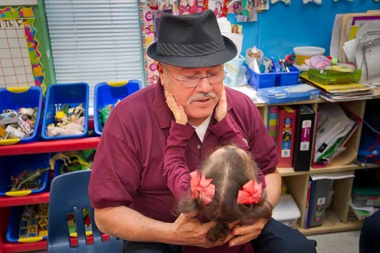 Andres Plaza with granddaughter Nelania Hidalgo.