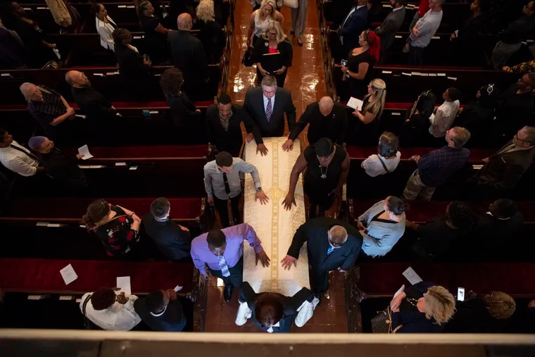 The casket of Deputy Sheriff Dante Austin is brought out of the Church of Saint Luke and The Epiphany after his funeral service in Philadelphia Saturday.