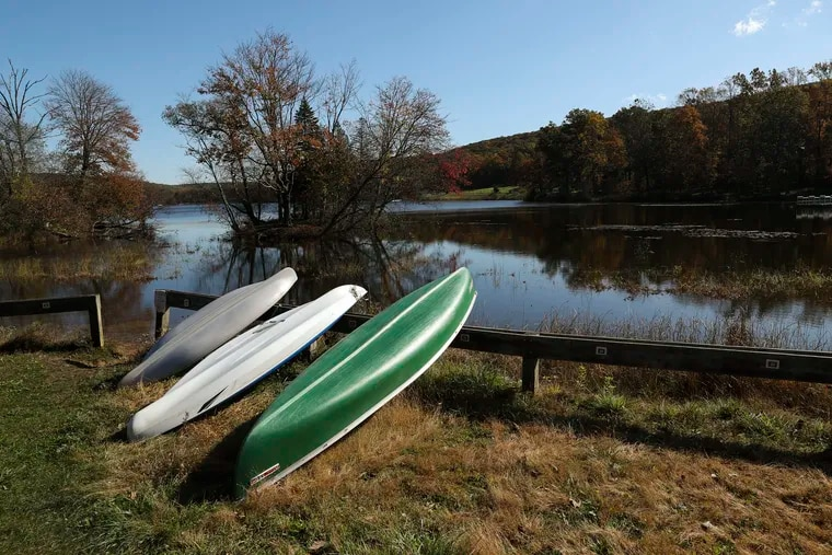 Boats are stored near Hopewell Lake at French Creek State Park in Elverson, Pa. on Wednesday, Oct. 23, 2019, during peak fall foliage time.
