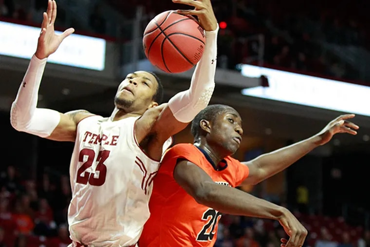 Temple's Devontae Watson, left, and Bucknell's Nana Foulland, right, battle for a rebound. (Charles Fox/Staff Photographer)