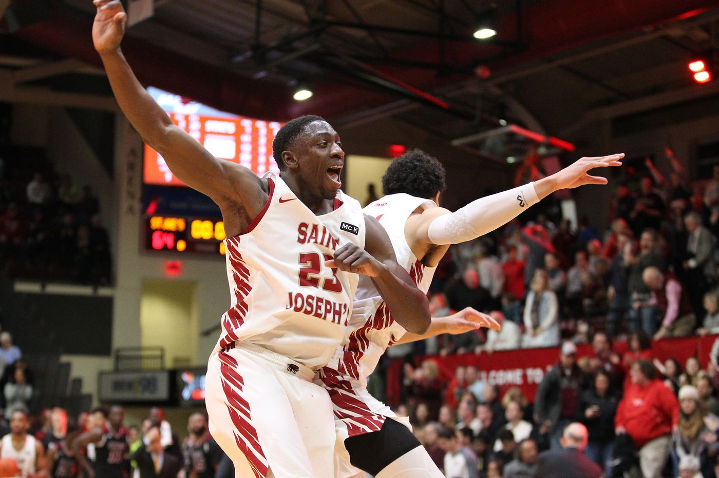 Charlie Brown and Lorenzo Edwards carry St. Joseph's past UMass, 64-62