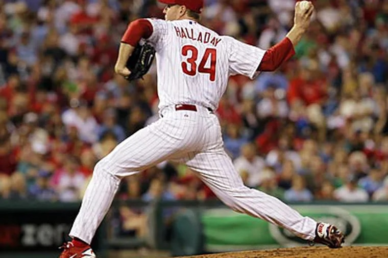 Roy Halladay pitched seven innings, allowed two runs on seven hits, and struck out 10 on Saturday. (Alex Brandon/AP)