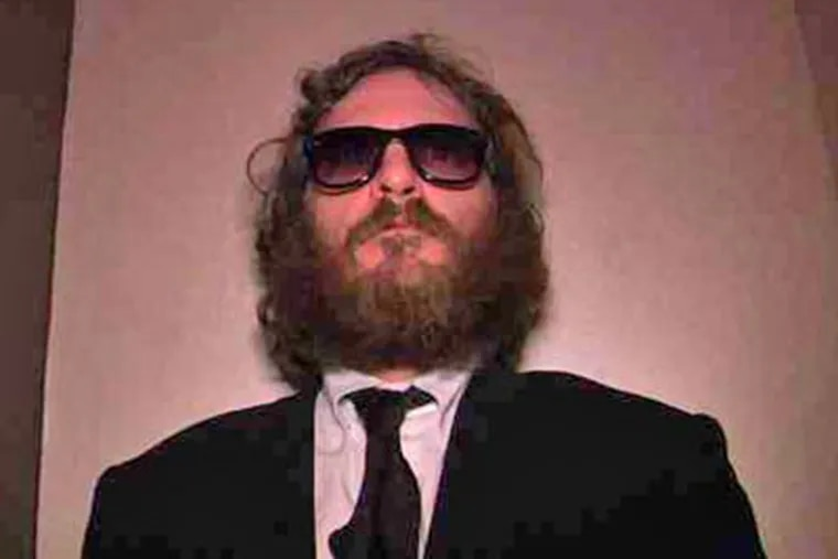 Joaquin Phoenix in the documentary-like movie that follows the actor for a year as he announces his retirement to become a hip-hop artist. (Magnolia Pictures)