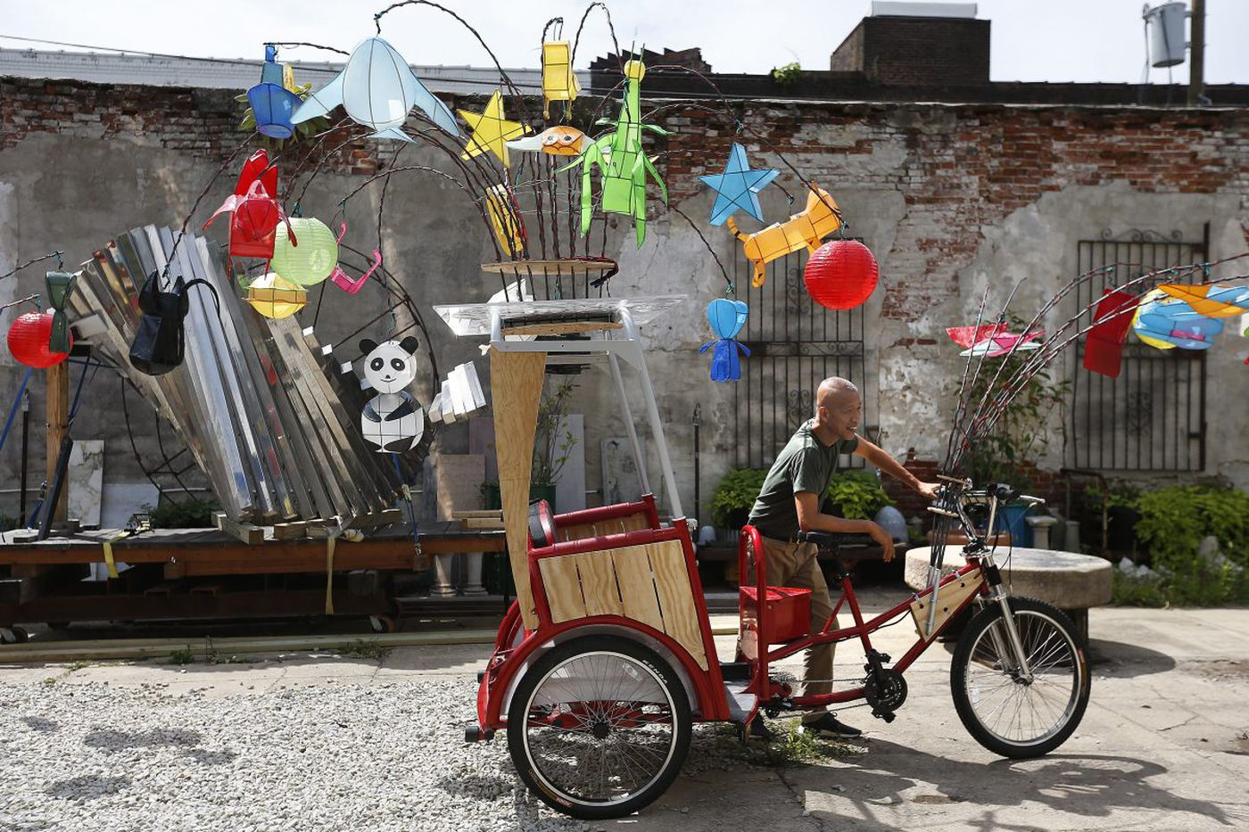 Art you can ride in: Beijing Olympics' fireworks guy is set to send glowing pedicabs up the Parkway