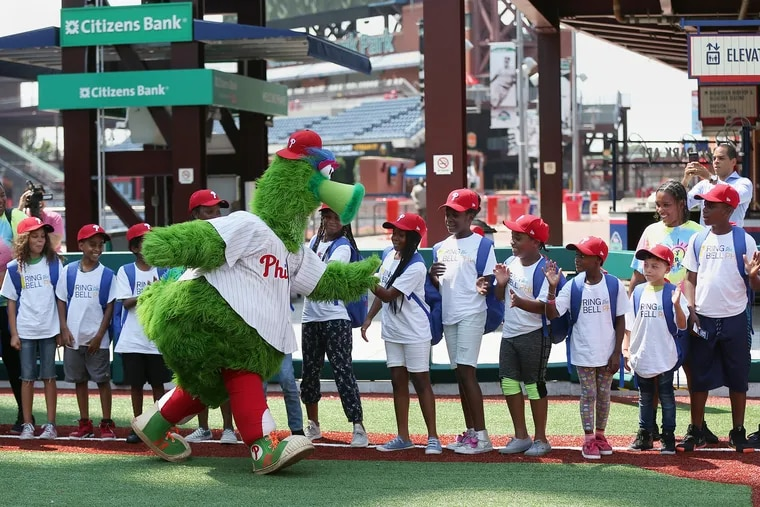 The Phillie Phanatic greets students at a pep rally to remind city residents that Philadelphia School District classes begin Aug. 27 this year — the first time the district has started before Labor Day.