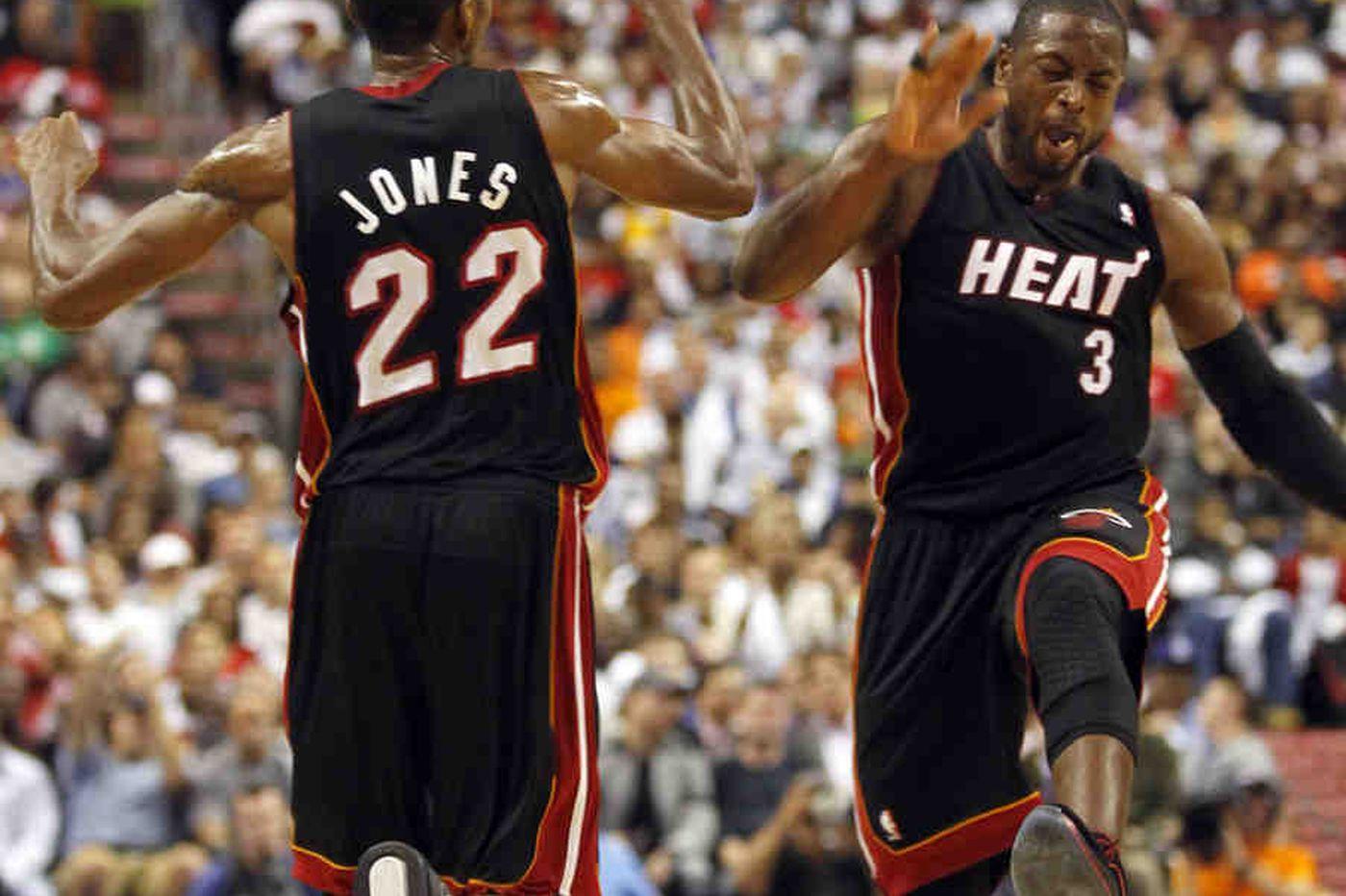 Heat's three stars not in sync yet