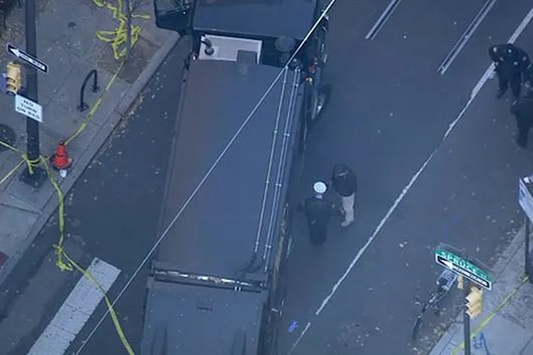 Overhead look at the scene of an accident at 11th and Spruce Streets on Tuesday. A female bicyclist was killed after being struck by a garbage truck.