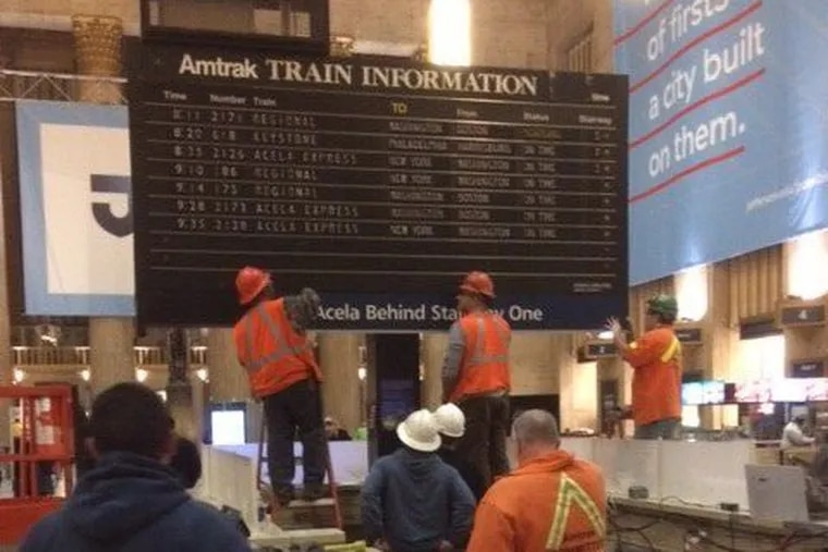 Work begins on dismantling the iconic flipboard at Amtrak's 30th Street Station.