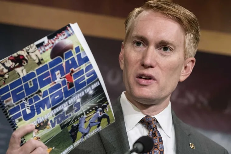 Sen. James Lankford, R-Okla., a member of the Senate Appropriations Committee, holds a news conference to outline the release of his report on wasteful spending in the federal government on Monday. He is seeking to insert a provision into the tax-cut bill that would create a revenue backstop.