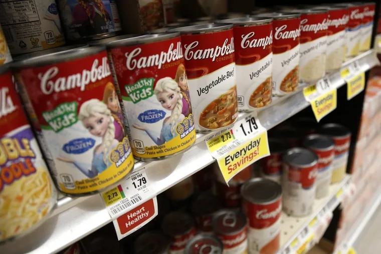 Campbell Soup Co.'s proposed $4.9 billion acquisition of snack manufacturer Snyder's–Lance will shift the Camden company's center of gravity away from its namesake canned soups, shown here in an Englewood, N.J., supermarket in May.