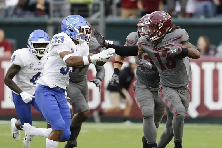 Temple wide receiver Isaiah Wright runs past a Buffalo player early in the season.