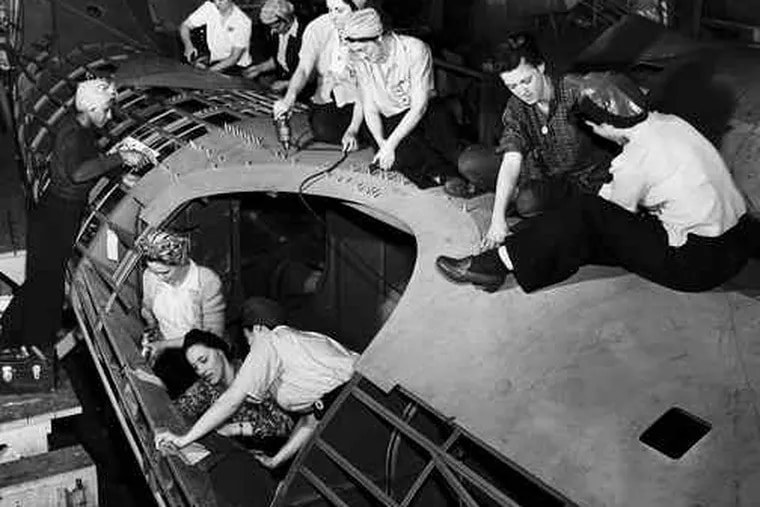 Women riveting a turret at the Navy Yard's aircraft factory in 1943. Workers saw more cash than ever before, but rationing meant fewer ways to spend it.