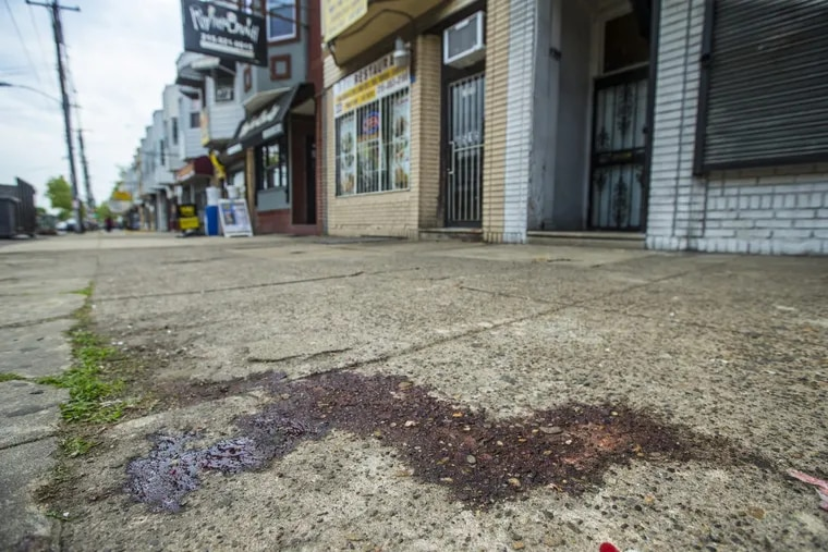The sidewalk outside BI's Restaurant on Elmwood Avenue was still stained Thursday with the blood from the previous night's shooting in which police said a customer used a registered gun to fatally shoot two men.